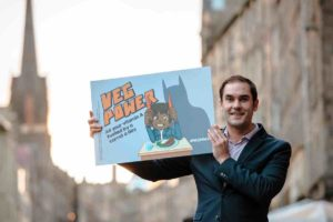 Edinburgh Council leader Adam McVey holding a Veg Power sign